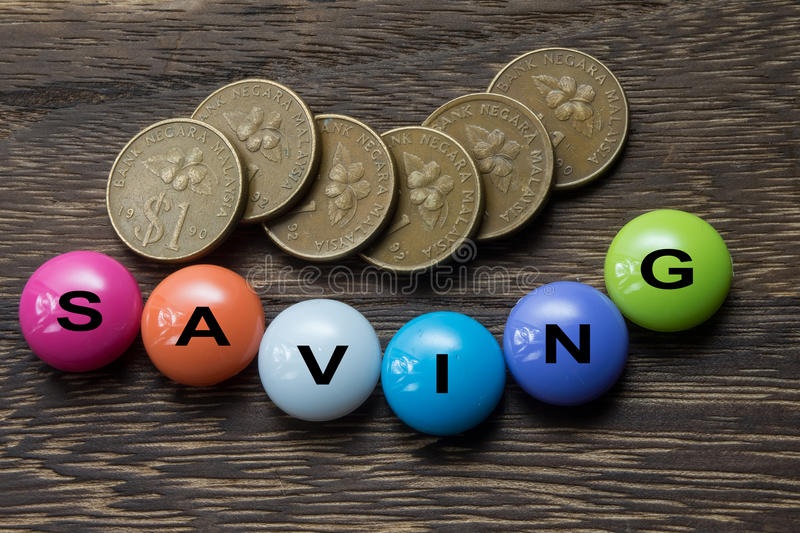 Saving Button with coins royalty free stock photography