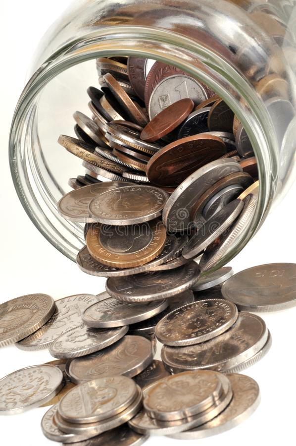 Jar of overturned coins in close-up royalty free stock photo