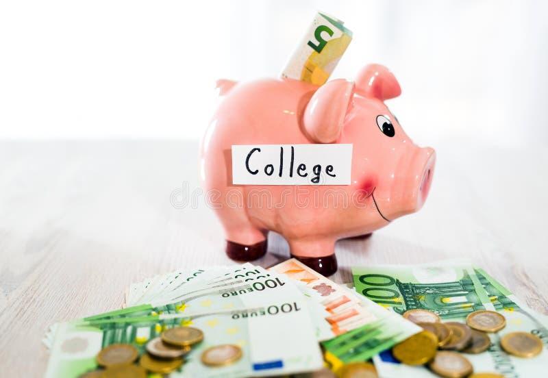 Saving concept. Piggy bank with an inscription college stock photos