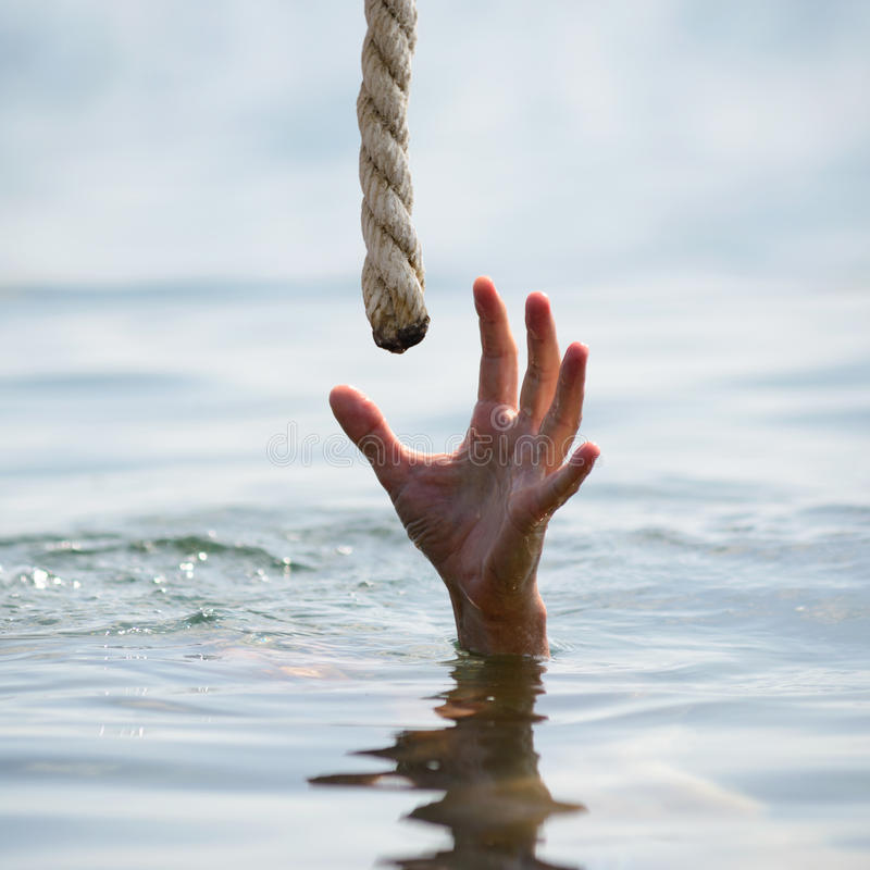 Saving a drowning man. Hand drowning on the sea