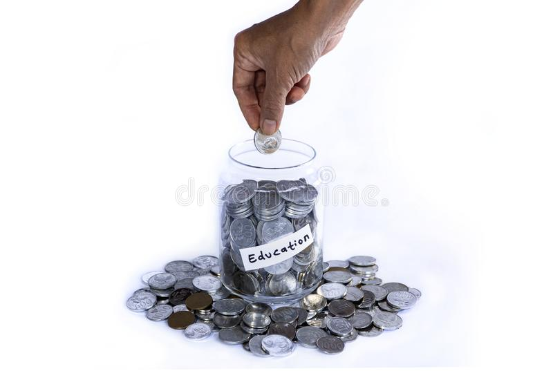 Saving idr coins in the glass bottle jar for vacation on white background stock photography