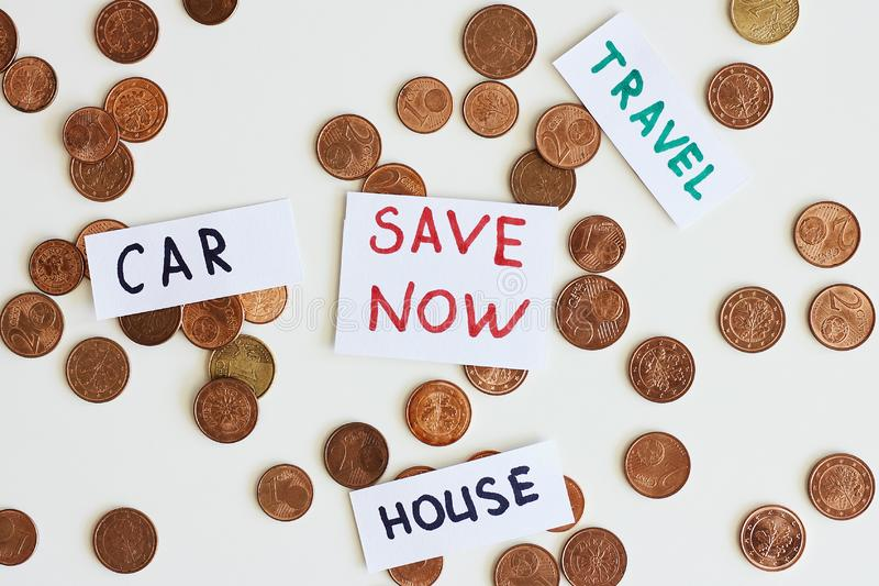 Saving money for the best life concept. Coins and signs travel, car, house, save now stock photos