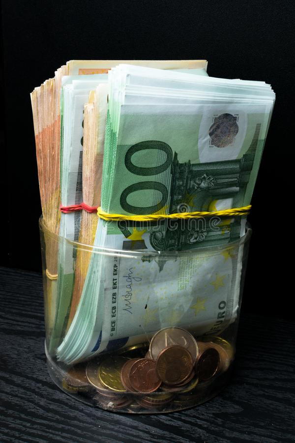 Saving money box with euro banknotes, cents. Banknotes of the european union. Euro cash background. stock image