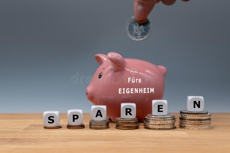 Saving money for buying a house. stock photo