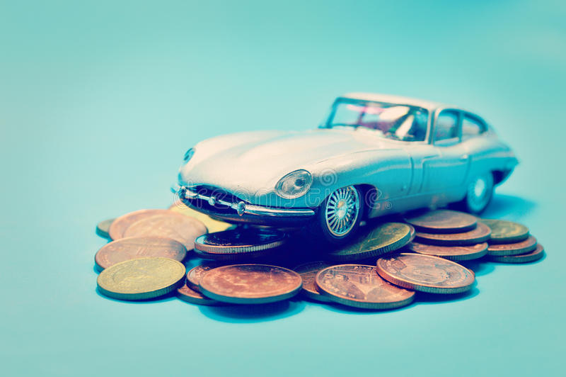 Saving money for car business concept. Retro effect image stock photography