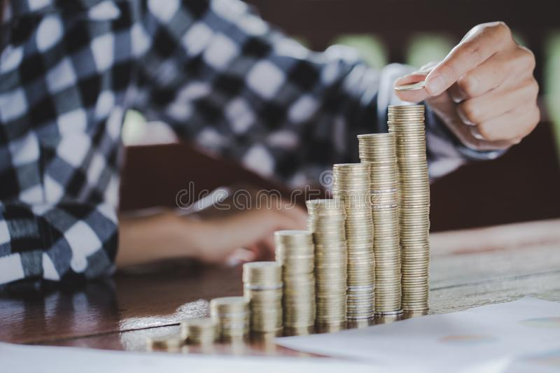 Saving money concept, coin stack growing business, save money for investment.  stock photo