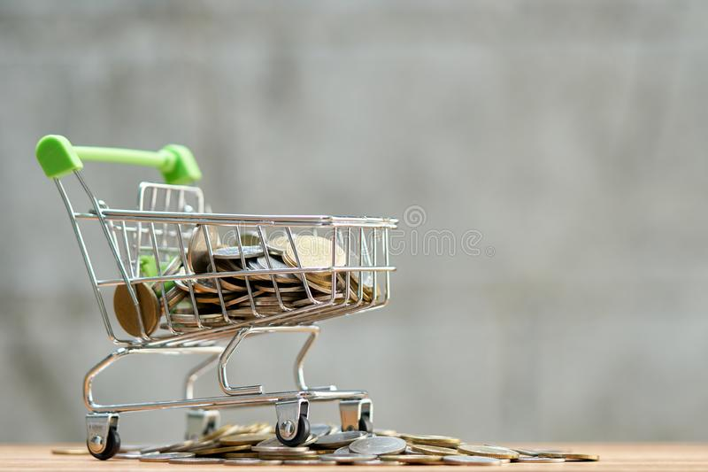 Saving money concept of collecting coins Thai money in a Shopping Cart on nature background. as background business concept and stock photos