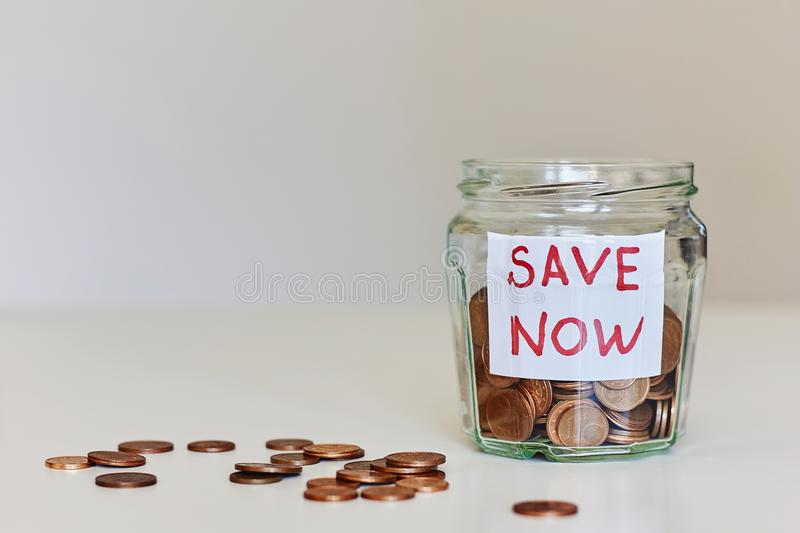 Saving money concept. Glass jar full of coins royalty free stock photo