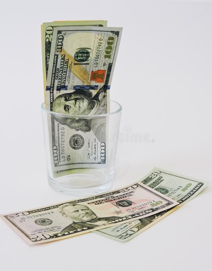 Saving money concept.Glass jars with dollars and text: SAVE.Coins in glass jar for money saving financial concept - USA dollar. American dollars on white royalty free stock photos