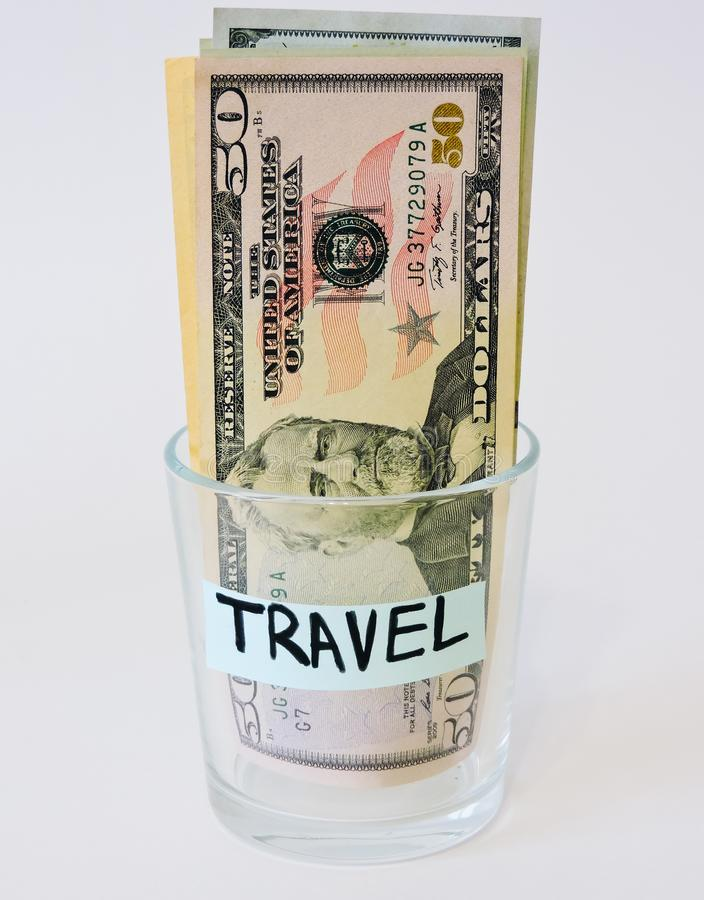 Saving money concept.Glass jars with dollars and text: SAVE.Coins in glass jar for money saving financial concept - USA dollar. American dollars on white royalty free stock photography