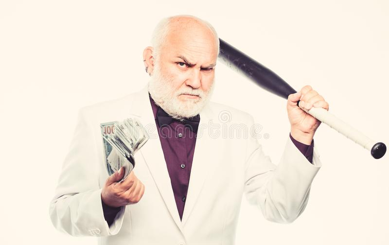 Saving money concept. Richness. criminal and robbery. debt pit. rich mature man has lots of money. mature bearded man royalty free stock images