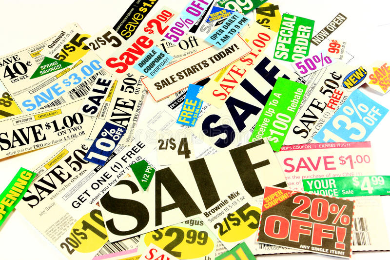 Saving Money With Coupons And Special Deals. A pile of assorted manufacturer's coupons and special store offers on a white background stock images
