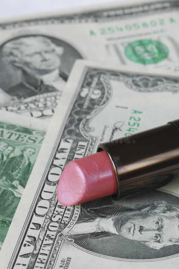 Saving money by cutting the expenses on cosmetics royalty free stock images