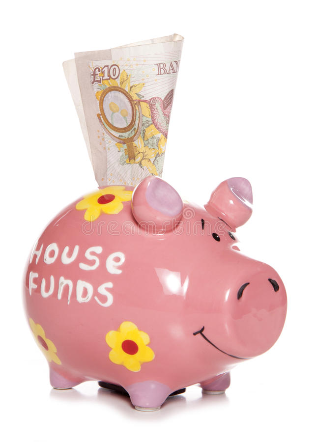 Saving money for deposit on a house royalty free stock photography