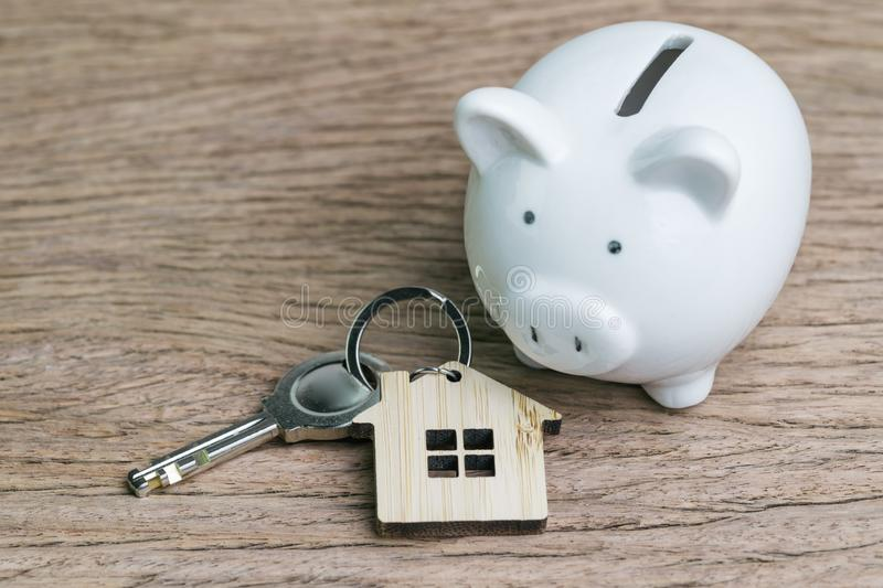Saving money for first house or home mortgage loan concept, key stock images