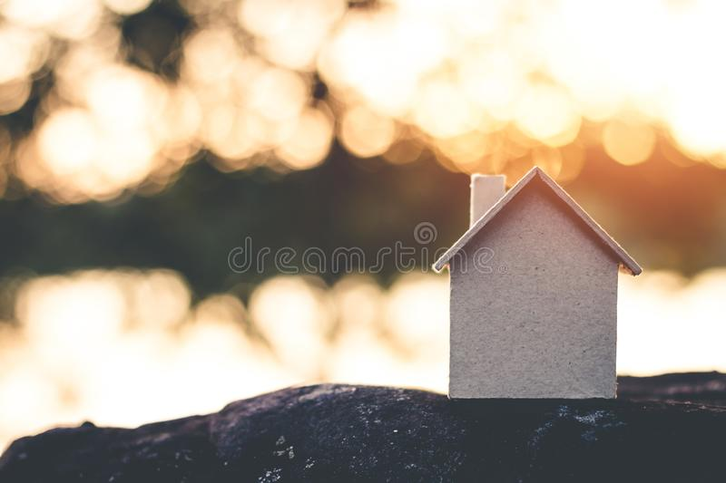 Saving money for future use in the small house. Saving money for future use in the small house, sustainability concept stock images