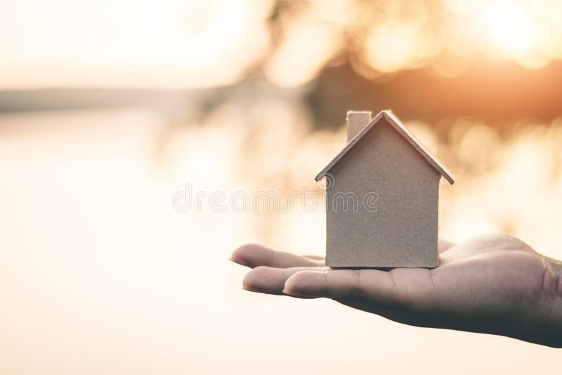 Saving money for future use in the small house. Saving money for future use in the small house, sustainability concept royalty free stock photo