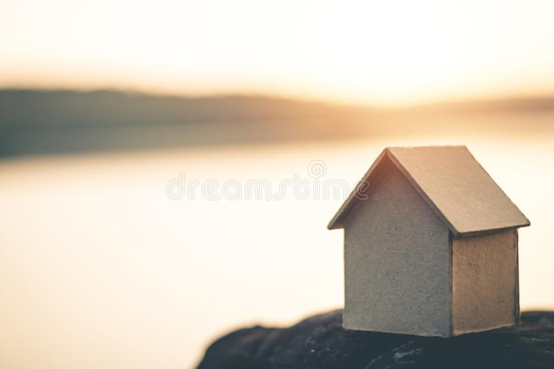 Saving money for future use in the small house. Saving money for future use in the small house, sustainability concept royalty free stock photos