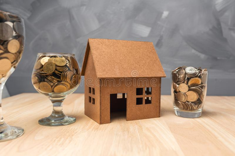 Saving money in the glasses bottle for buy a house real estate c royalty free stock images