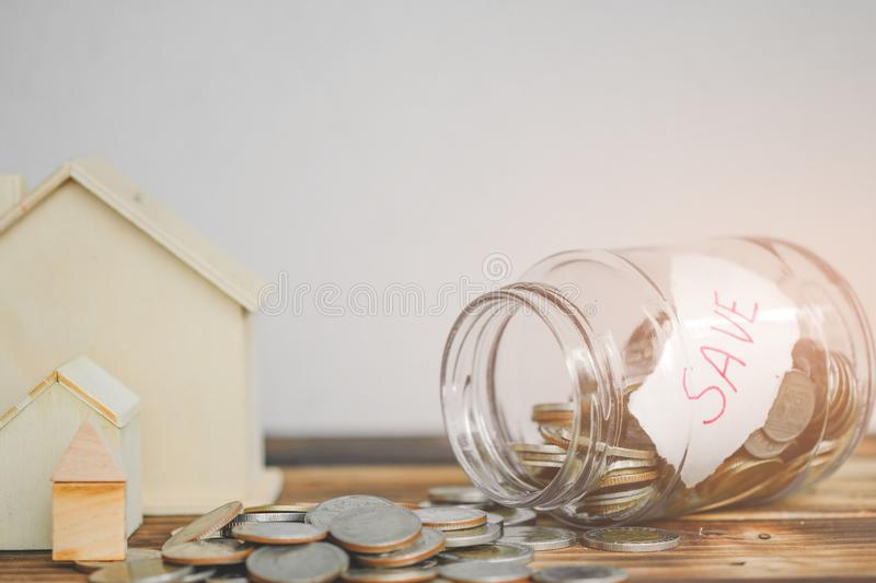 Saving money with hand putting coins in jar glass, save and investment money for prepare in the future stock photography