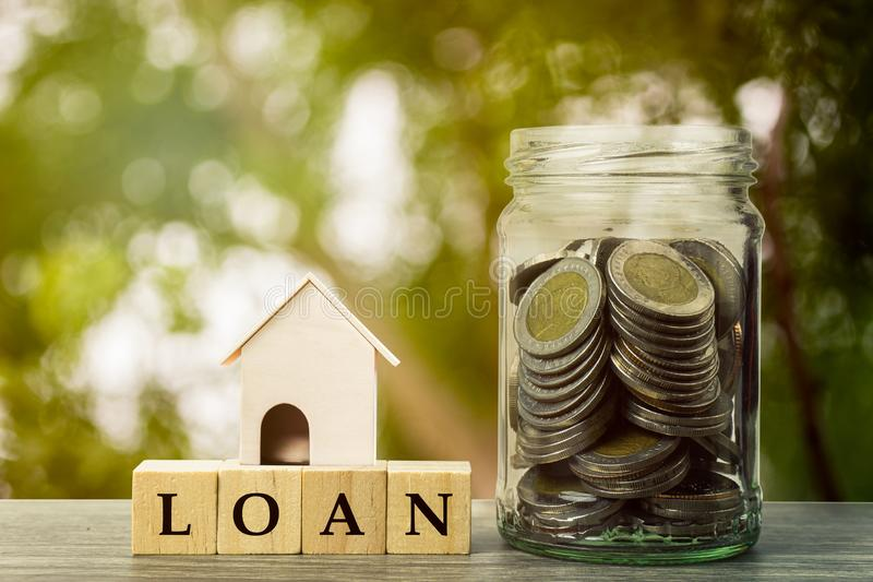 Saving money, home loan, mortgage, a property investment for future concept stock photography