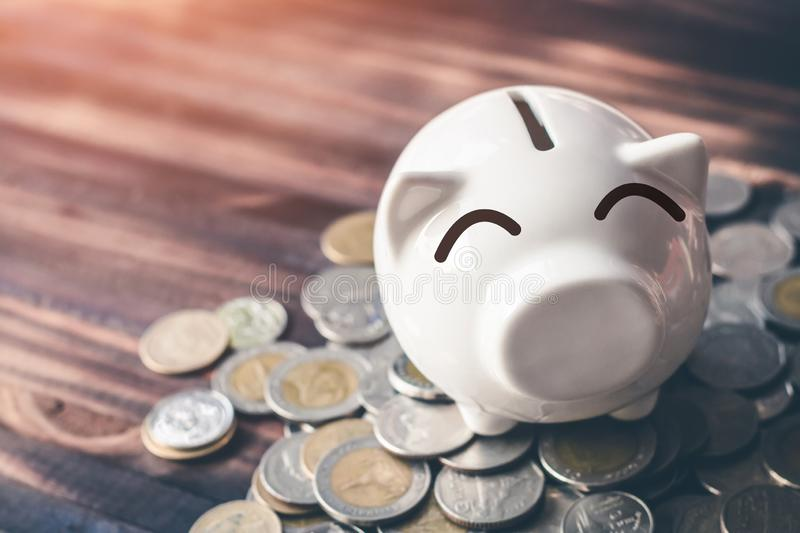Saving money in pig bank for future use, Concept saving money for the future.  royalty free stock image