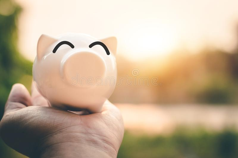 Saving money in pig bank for future use, Concept saving money for the future.  stock photos