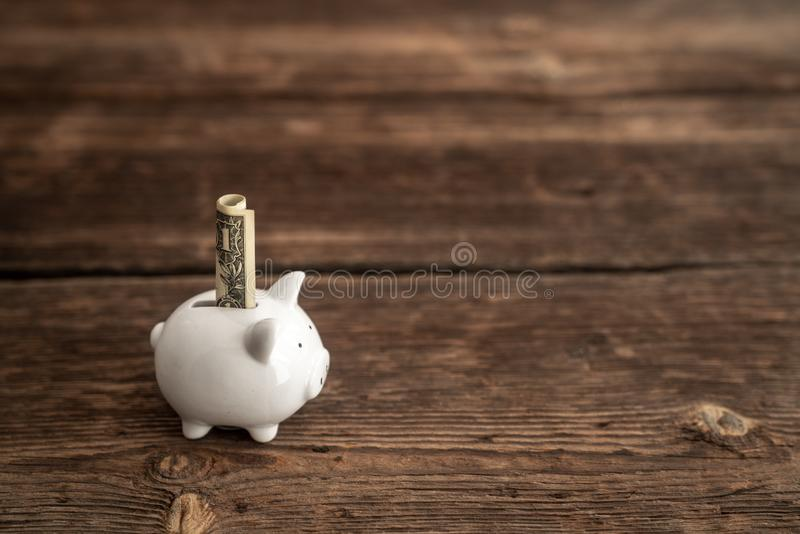 Saving money in piggy-bank, a metaphor to financial business and economy stock photo