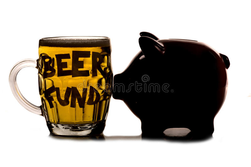 Saving money for a pint of beer. Cutout royalty free stock photo