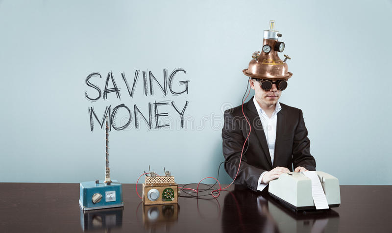 Saving money text with vintage businessman at office royalty free stock photo