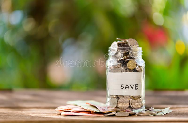 Saving money to save money on glass bottles / ideas to create a future. Copy space royalty free stock images