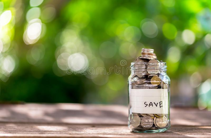 Saving money to save money on glass bottles / ideas to create a future. Copy space stock photo