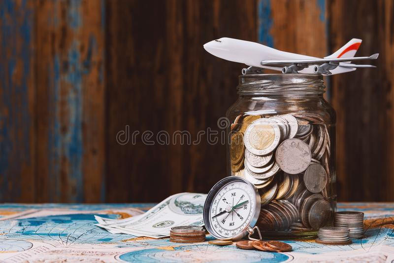 Saving money for traveling concept stock photography