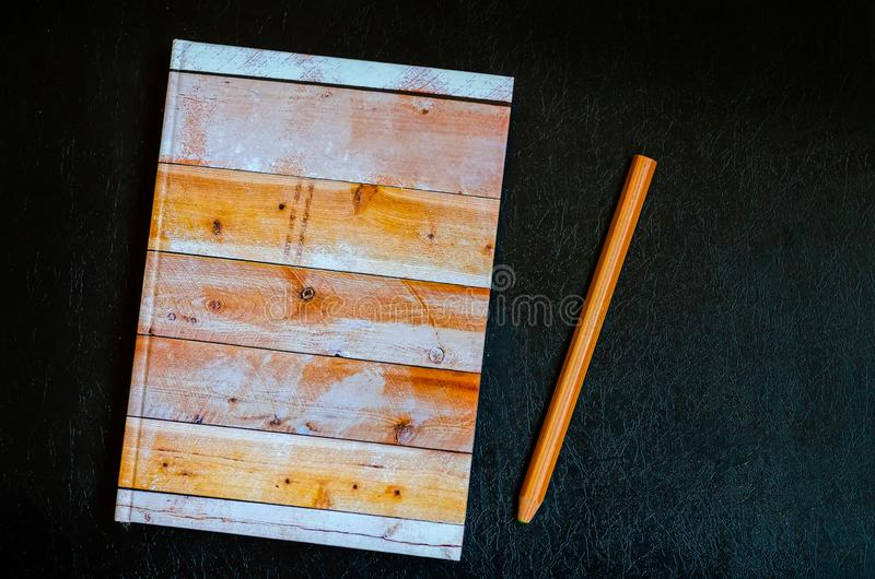 Notepad and pencil on the writer`s desktop. Before writing a new chapter. Without people. View from above. Saving notes after a long trip. Nice memories stock photography