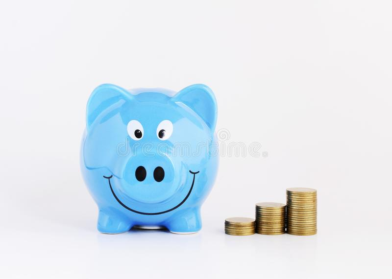 Saving plan concept with Blue piggy bank and money coins stack on white background. Saving plan concept with Blue piggy bank and money coins stack macro close up stock photography