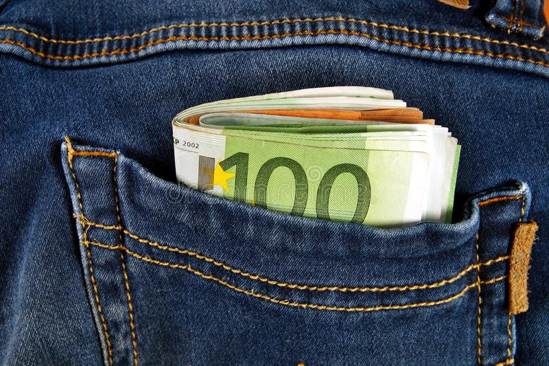 Euro money cash, euro banknotes in the pockets of jeans trousers. banner for web, gift card, postcard. Concept of wealth,. Saving or spending money. Euro bills stock photos