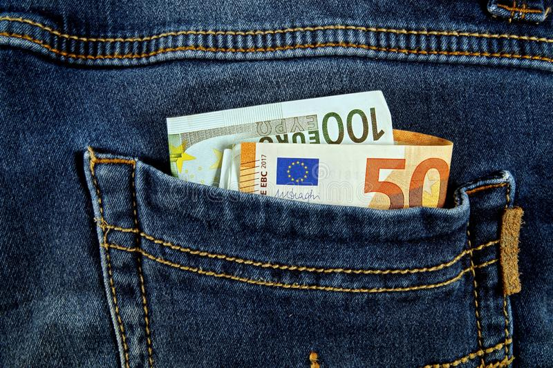 Euro money cash, euro banknotes in the pockets of jeans trousers. banner for web, gift card, postcard. Concept of wealth,. Saving or spending money. Euro bills stock image