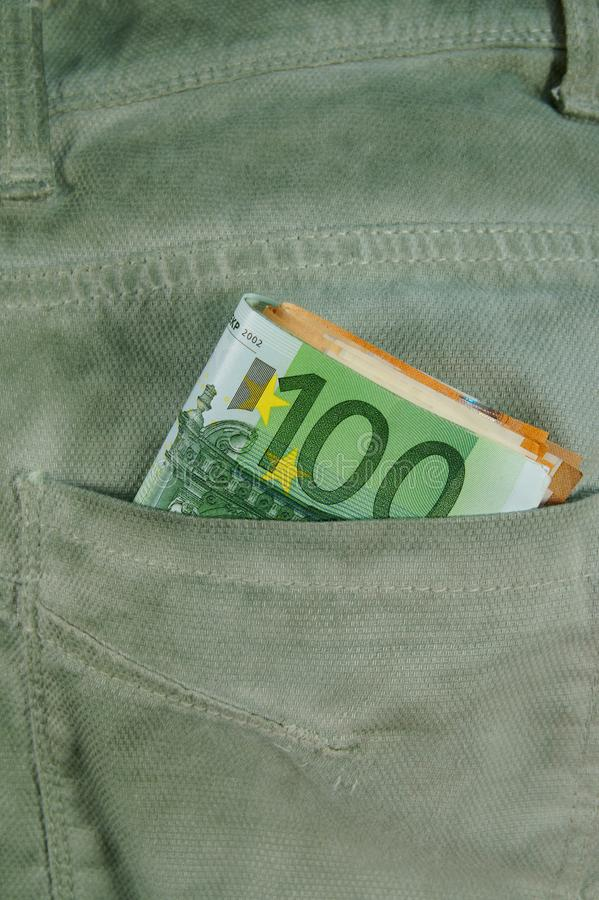 Euro money cash, euro banknotes in the pockets of trousers. banner for web, gift card, postcard. Concept of wealth,. Saving or spending money. Euro bills falling stock images