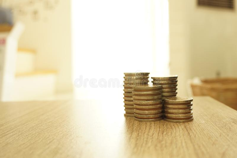 Saving stack coins money concept on desktop desk in hipster office,copy space.selective focus,vintage color. royalty free stock photo