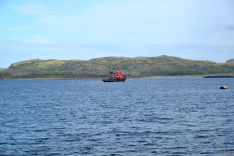 Saving tow in the water area of the Barents Sea at the coast of the Kola Peninsula stock photo