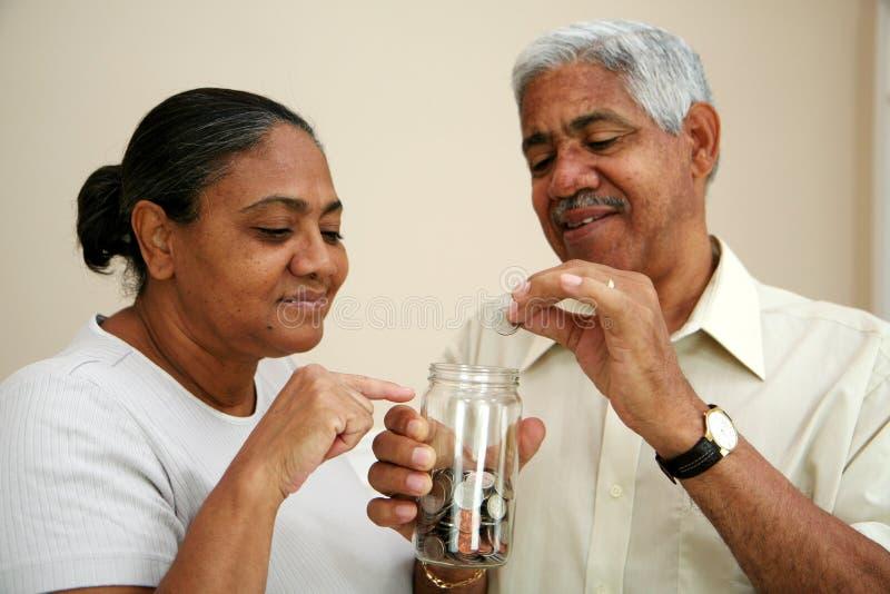 Savings. Saving coins in a jar stock images