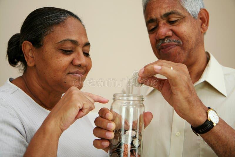 Savings. Saving coins in a jar stock image