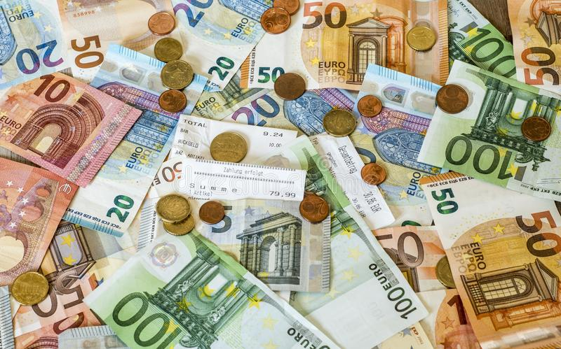Savings Cash money concept euro banknotes all sizes and cent coins on desk bill pay store text sum total save. Savings Cash money concept euro banknotes of all stock photos