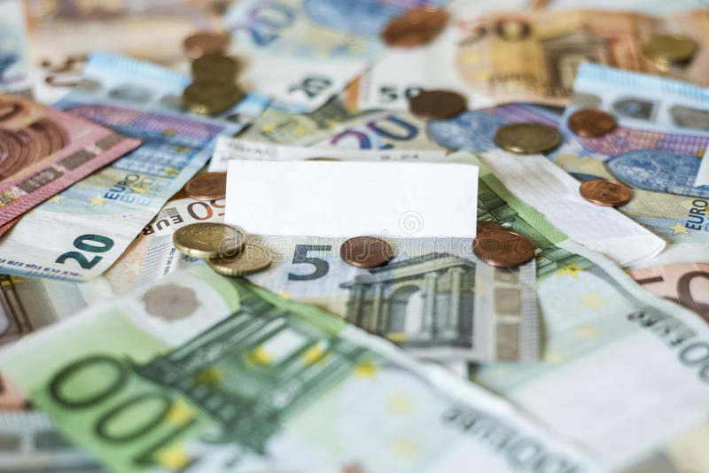 Savings Cash money concept euro banknotes all sizes and cent coins on desk bill pay store text sum total save. Savings Cash money concept euro banknotes of all royalty free stock photo
