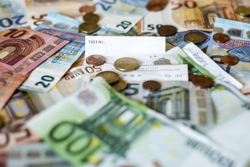Savings Cash money concept euro banknotes all sizes and cent coins on desk bill pay store text sum total save. Savings Cash money concept euro banknotes of all stock photo