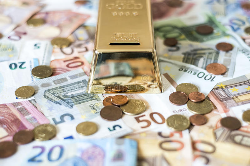 Savings Cash money concept euro banknotes all sizes and cent coins on desk piggy bank gold bar shape save. Savings Cash money concept euro banknotes of all sizes royalty free stock photography