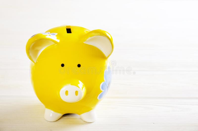 Savings concept. Piggy bank and money on dark wood background. Savings concept. Piggy bank and money on dark wood backgraund.Savings concept. Piggy bank and stock photography