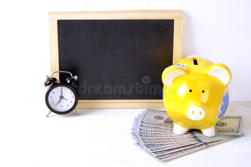 Investing time and money into education concept. Different school supplies, banknotes. Top view, close up. royalty free stock photos