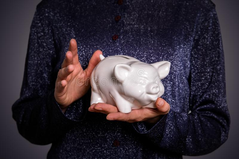 Savings and finance concept. Piggy bank in hands stock photography