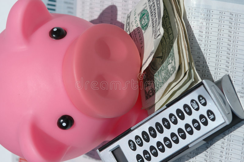 Savings Financial Still Life. A pink piggy bank, american dollars and a calculator on a financial data background representing savings and investments royalty free stock photo